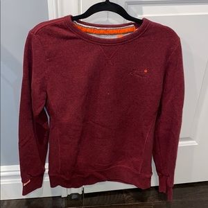 Burgundy Superdry crew neck sweatshirt.